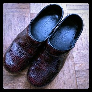 Dansko patent leather snakeskin clogs